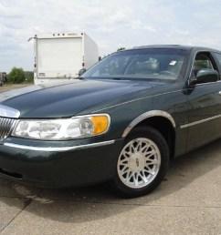 1999 dark satin green metallic lincoln town car signature 32855867 [ 1024 x 768 Pixel ]