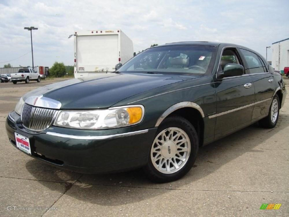 medium resolution of 1999 dark satin green metallic lincoln town car signature 32855867