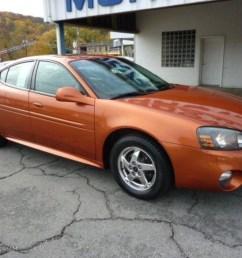 2004 fusion orange metallic pontiac grand prix gt sedan 38689812 photo 2 [ 1024 x 768 Pixel ]