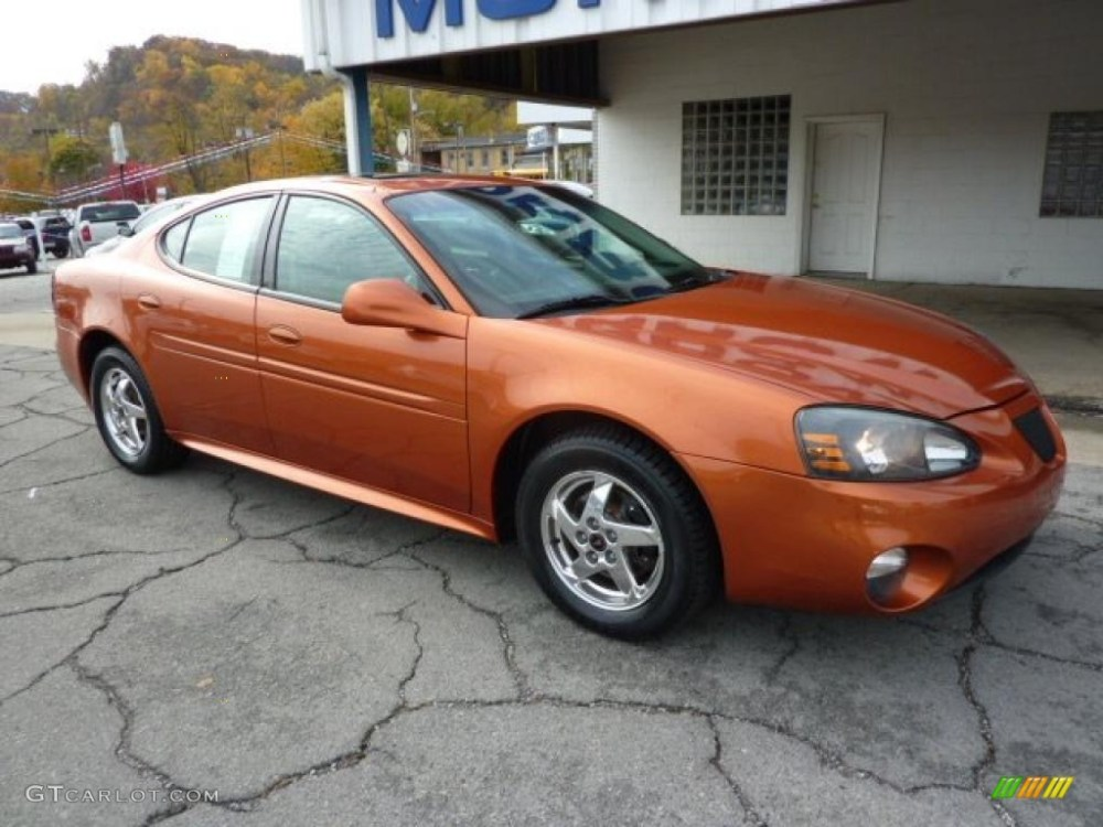 medium resolution of 2004 fusion orange metallic pontiac grand prix gt sedan 38689812 photo 2