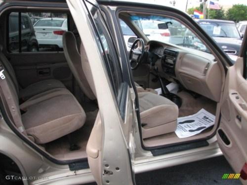 small resolution of medium prairie tan interior 1999 ford explorer xlt 4x4 photo 39822586