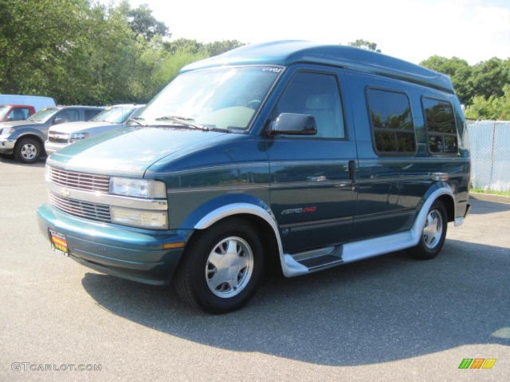hight resolution of 2000 astro awd passenger conversion van teal blue metallic medium gray photo 1