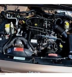 2000 jeep cherokee sport 4x4 4 0 liter ohv 12 valve inline 6 cylinder engine photo [ 1024 x 768 Pixel ]