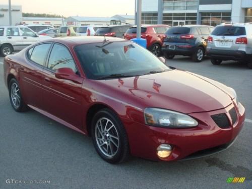 small resolution of 2004 grand prix gtp sedan sport red metallic dark pewter photo 1