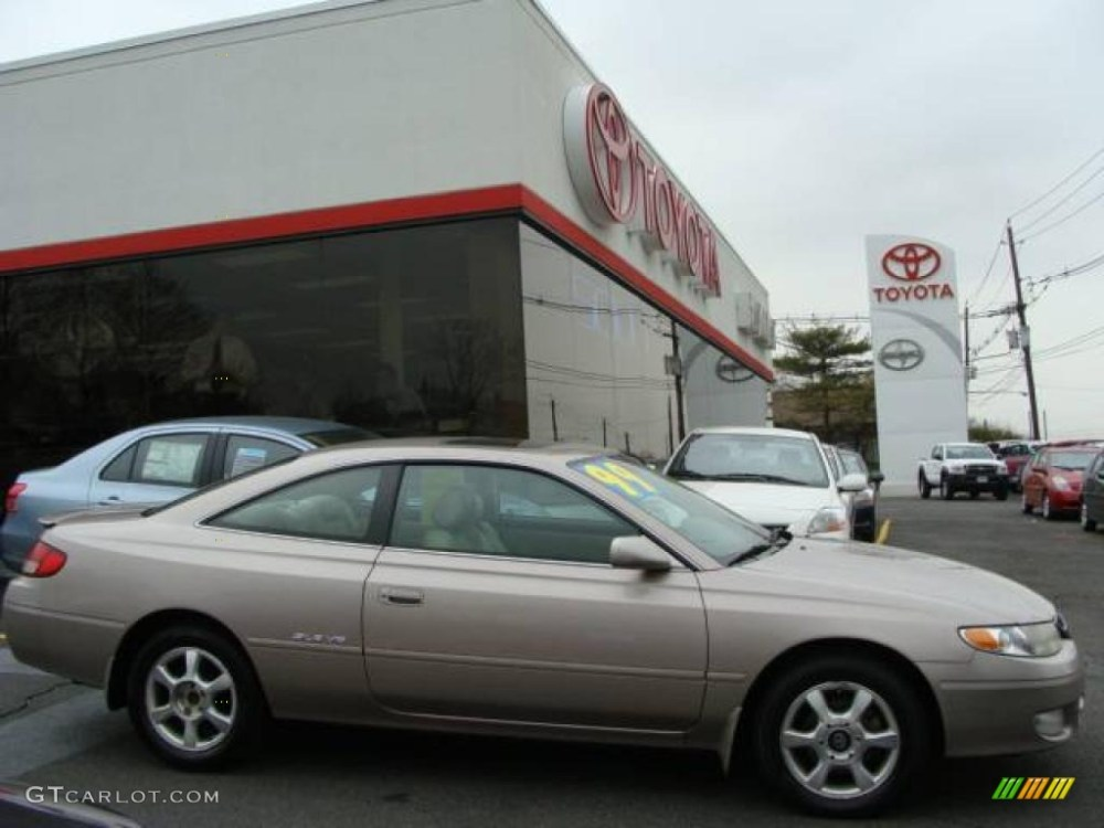 medium resolution of 1999 sandrift metallic toyota solara sle v6 coupe 7356955