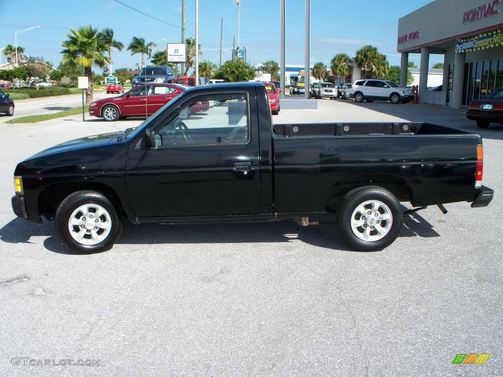 hight resolution of super black nissan hardbody truck