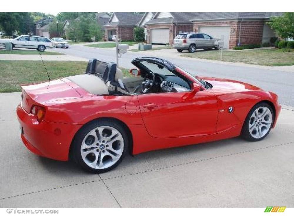 medium resolution of 2004 bright red bmw z4 3 0i roadster 9881721