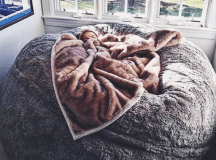 This Lovesac ~pillow chair~ is as big as a bed and you'll ...