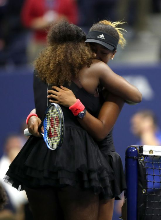Naomi Osaka and Serena Williams hugging at U.S. Open