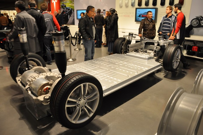 electric-car battery costs: tesla $190 per kwh for pack, gm $145 for