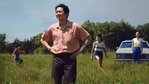 """This image released by A24 shows Steven Yeun, foreground, in a scene from """"Minari."""" The Screen Actors Guild has nominated the cast for a SAG Award for outstanding performance by a cast in a motion picture. (David Bornfriend/A24 via AP)(AP)"""