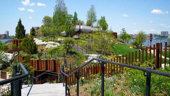 A stairway leads to one of the highest points of Little Island, a new Hudson River Park, on Tuesday, May 18, 2021, in New York. Designed to create an immersive experience combining nature and art, the park is scheduled to open to the public Friday. There are two amphitheaters, a casual outdoor dining space, winding footpaths and stairways leading to multiple views of the city and a playground. (AP)