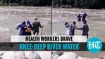 A team of health workers crossed a knee-deep river to conduct vaccination drive in J&K