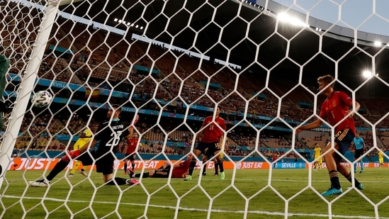 """""""How did that not go in?"""", you may ask.  The best chance of the first half, surprisingly, came off the boot of Sweden's Alexander Isak.  His shot was deflected onto the post by Llorente and the ball then bounced back to Spain goalkeeper Unai Simon. (AP)"""