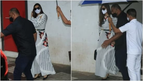 Sonam wore the chic outfit with black pointed heels, a top handle bag, tinted sunglasses and side-parted open locks. She also wore a white face mask to stay safe during the pandemic.(Varinder Chawla)