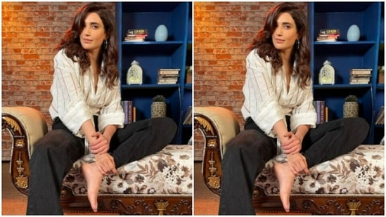Karishma set the mood for her Instagram family with a ochre and white striped shirt and a pair of black trousers.(Instagram/@karishmaktanna)