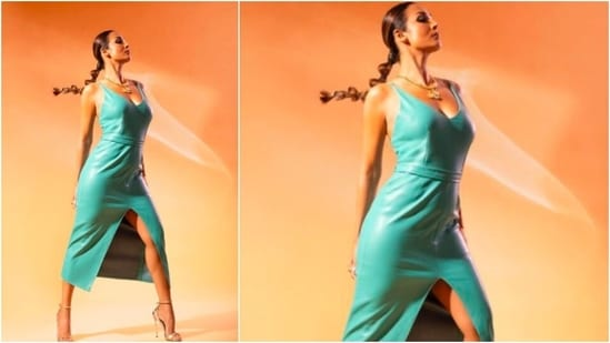 Malaika Arora struck some amazing poses for her photoshoot in the blue body-hugging leather dress.(Instagram/@manekaharisinghani)