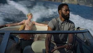 This image released by Warner Bros. Entertainment shows Elizabeth Debicki, left, and John David Washington in a scene from Tenet.(AP)
