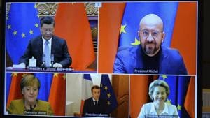 A screen displays live Chinese President Xi Jinping, top left, European Council President Charles Michel, top right, European Commission President Ursula von der Leyen, bottom right, French President Emmanuel Macron, bottom centre, and German Chancellor Angela Merkel during an EU-China Leaders' meeting video conference(AP)