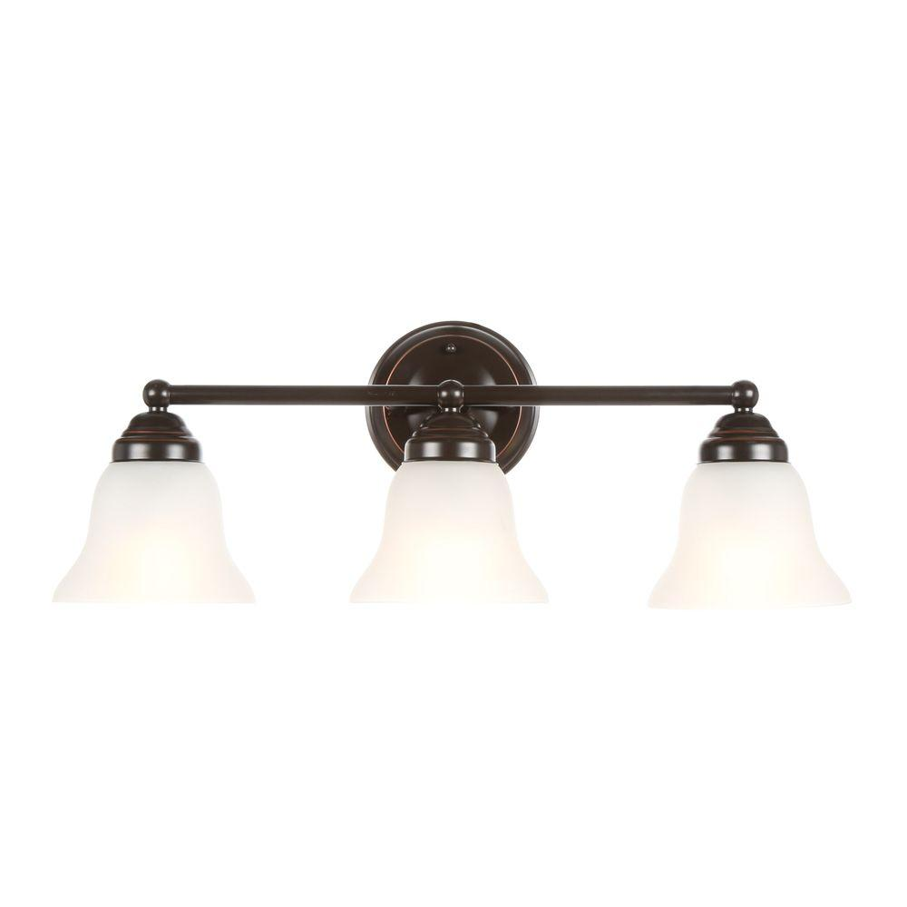 medium resolution of hampton bay 3 light oil rubbed bronze vanity light with frosted glass shades