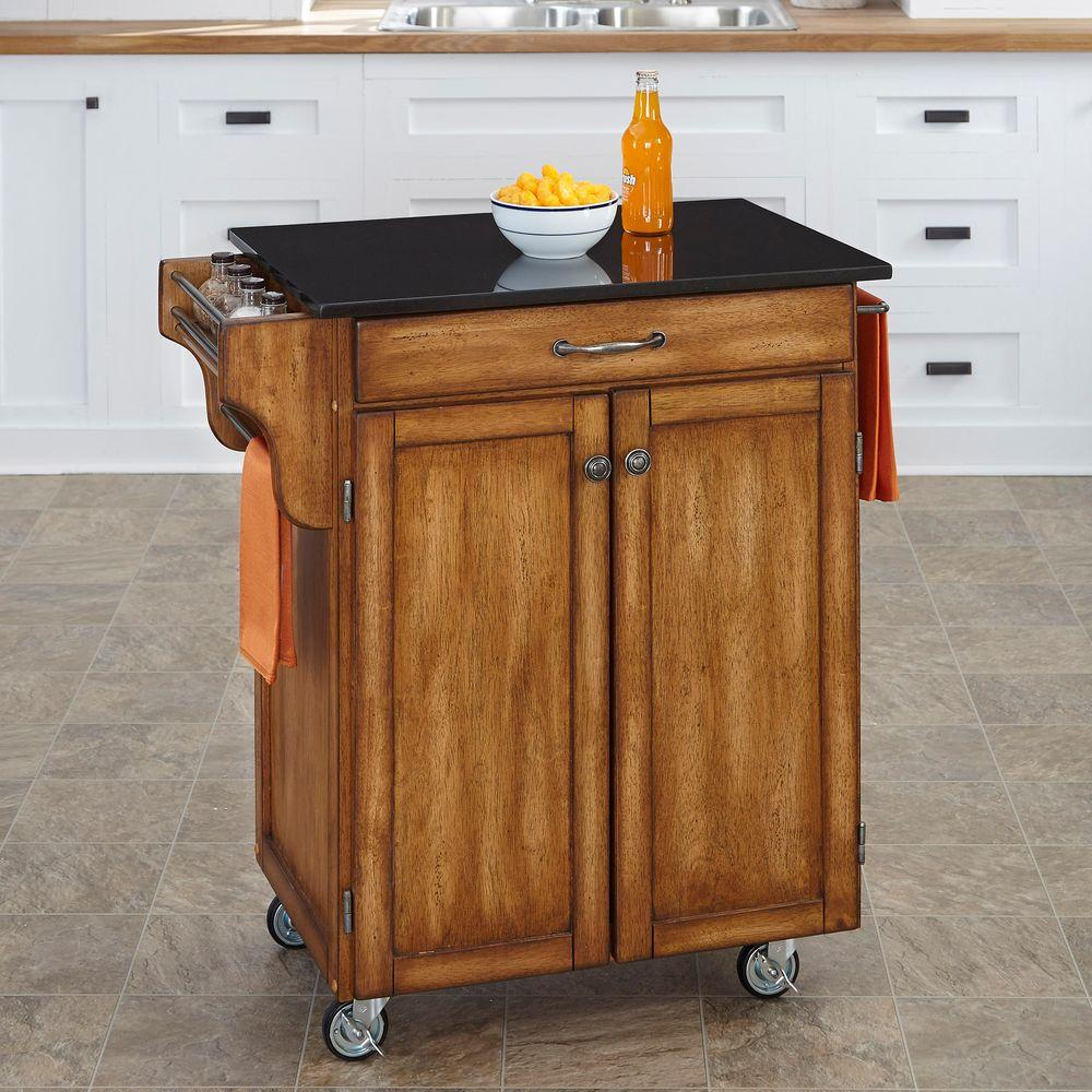 oak kitchen cart light home styles create a warm with black granite top