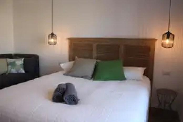 Dormitorios de estilo ecléctico de studio ferlazzo natoli
