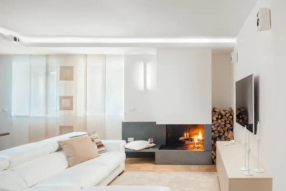 Camino in pietra lavica soggiorno in stile in stile