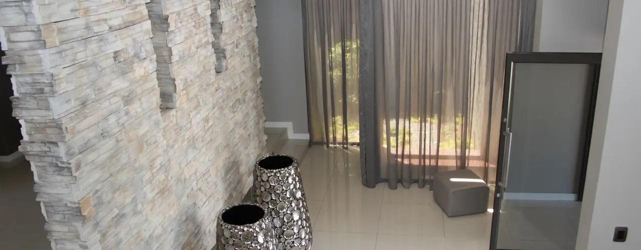 12 Maneras de decorar tu paredes con piedra y que se vea