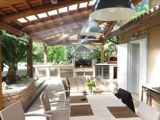 15 terrazas con asador que te encantar tener en casa