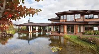 Дом в стиле современного шале с водоемом и садом