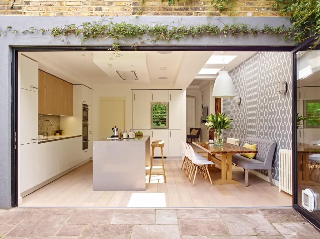Kitchen dining room and folding doors opening to garden modern kitchen by holloways of ludlow