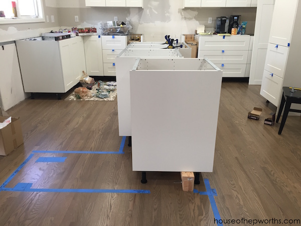 ikea kitchen island cut gloves for everything you want to know about building a custom screwing 2x4s and l brackets into our brand new floor was nerve racking we used as the base attach cabinets s