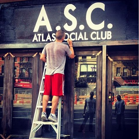 2013-09-08-Pablo Raimondi painting the sign for he and his friend's Atlas Social Club-pABLOPAINTING.jpg
