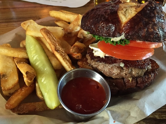 Brie-covered burger and fries at Blasted Barley. (Photo by Scott Bridges)
