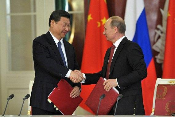 2015-04-26-1430008851-4540631-Xi_Jinping_and_Vladimir_Putin__EDM_September_17__2013.jpg