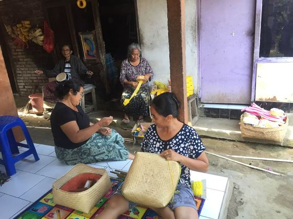 Local Villagers work on handmade crafts