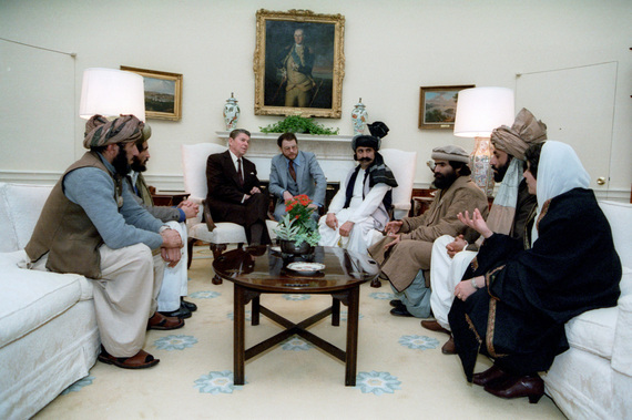 2015-11-18-1447858210-6613522-Reagan_sitting_with_people_from_the_AfghanistanPakistan_region_in_February_1983.jpg
