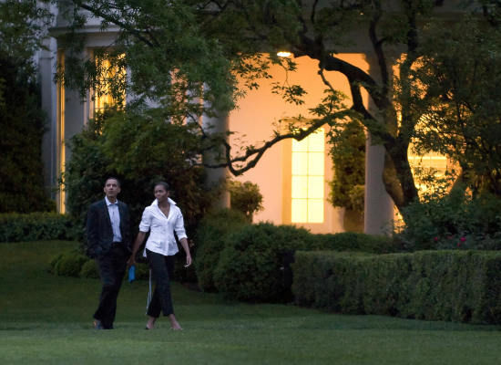 The President and First Lady stroll the White House grounds after returning from dinner out at Citronelle on their first date night since taking office.  Saturday, May 2, 2009.