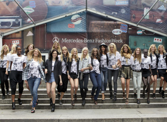 Models form a line on the steps of the park