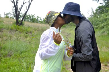 Love on the trail. A couple share a kiss after picking flowers from the trail.jpg