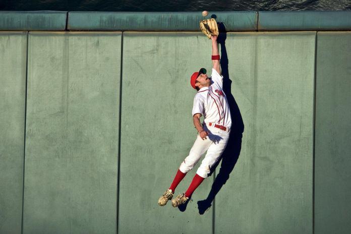 baseball player agile jumping and flying