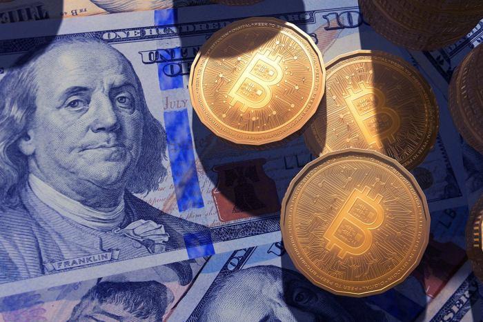 bitcoins and dollar bills