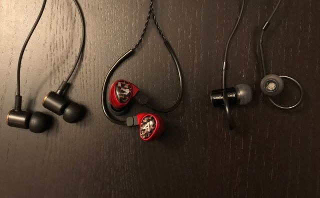 In-ear-headphones use friction (Periodic Audio Be, left), wrap around your ear (A&K Billie Jean, mid