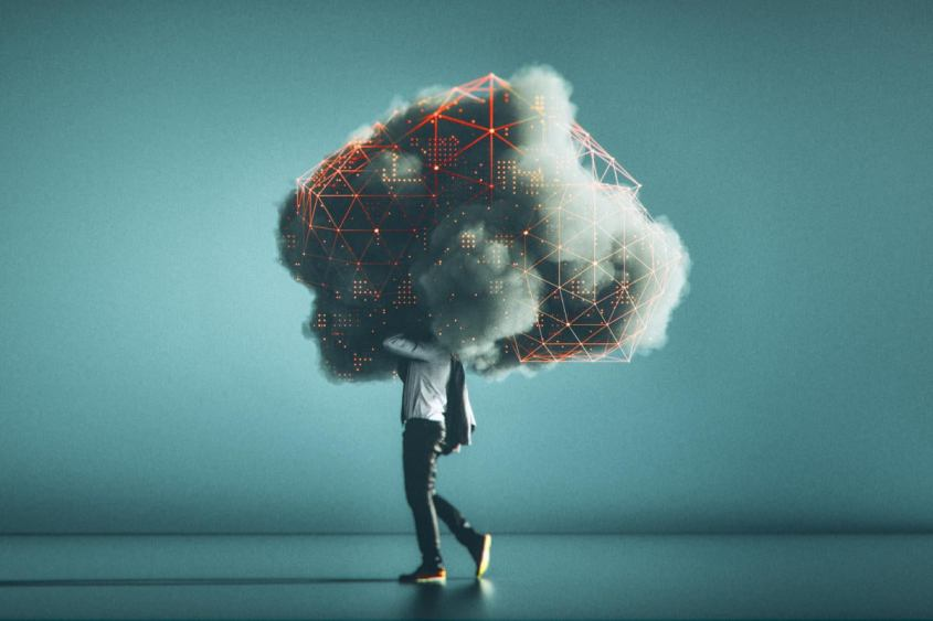 A man with his head in a complex, complicated cloud.