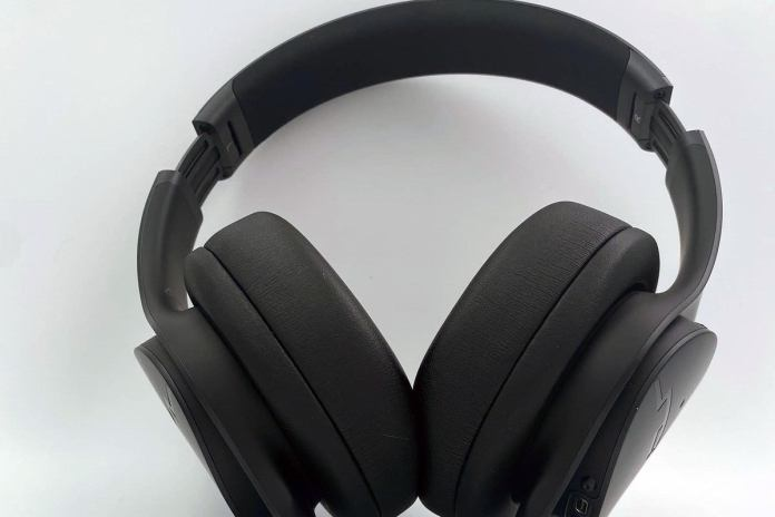 The headband has a soft, rubberized padding. The generously-sized ear cups maintain their shape well