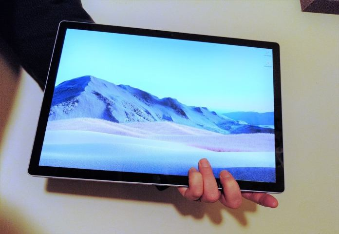 tablet in hand Microsoft Surface Book 3