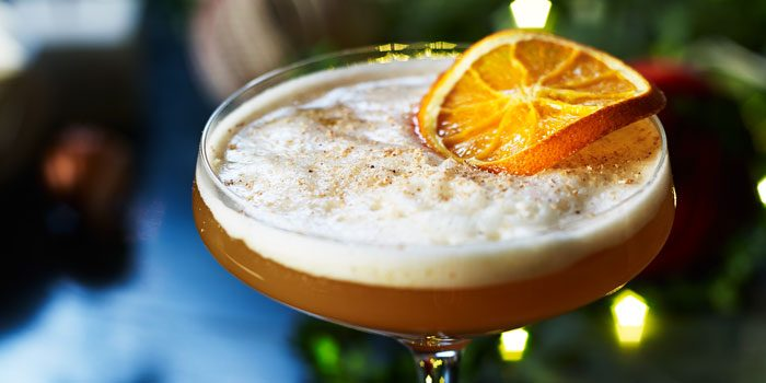 Cocktail with orange garnish