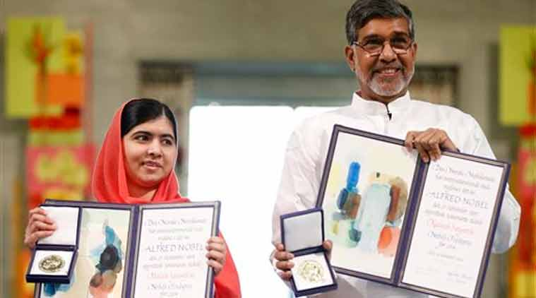 Nobel Peace Prize winners Malala Yousafzai from Pakistan and Kailash Satyarthi of India hold their Nobel Peace Prize diplomas and medals during the Nobel Peace Prize award ceremony in Oslo (Source: AP)