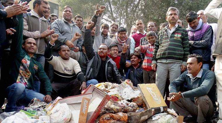 MCD workers shot slogans while piling up garbage near Deputy Chief Minister Manish Siosodia's office during a protest over their their demands in East Delhi last year. Credit: PTI/FIles