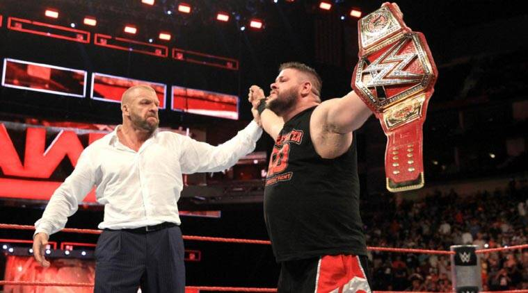 Image result for Triple H returns to RAW helps Kevin Owens win Universal title